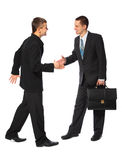 Two young businessmen greet. On white background royalty free stock image
