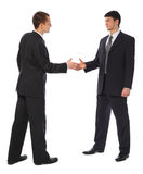 Two young businessmen greet. On white royalty free stock photography