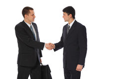 Two young businessmen greet Royalty Free Stock Images