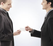 Two young businessmen holding a blank card Stock Photos