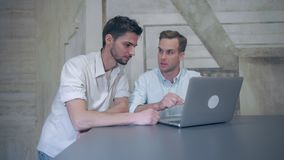 Two young businessmen informal meeting. royalty free stock photos