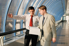 Two young businessmen on meeting. Talking the document royalty free stock photo