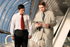 Two young businessmen on meeting. Talking the document royalty free stock photography