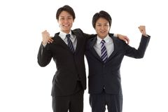 Two young businessmen posing guts Royalty Free Stock Image