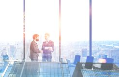 Men shake hands in conference room, skyscraper. Two young businessmen shaking hands in panoramic office conference room. Double exposure of skyscraper. Toned stock illustration