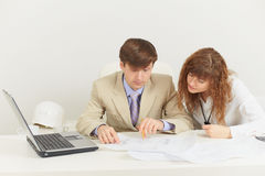 Two young businessmen work with documents Stock Photos