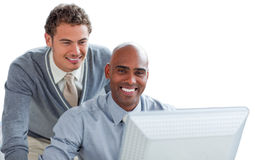 Two young businessmen working at a computer Royalty Free Stock Image