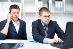 Two young businessmen working together at office Stock Photography