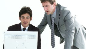 Two young Businessmen working together in an office. In High Definition stock video
