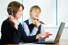 Two young businesswoman. Royalty Free Stock Images