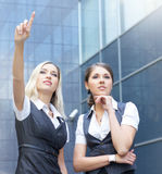 Two young businesswoman in formal clothes Stock Images