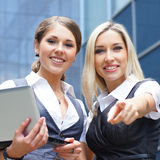 Two young businesswoman in formal clothes Stock Image