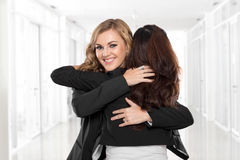 Two young businesswoman have a reconciliation Stock Photo
