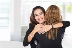 Two young businesswoman have a reconciliation,  Royalty Free Stock Images