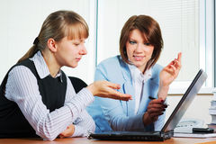 Two young businesswoman using laptop Stock Image