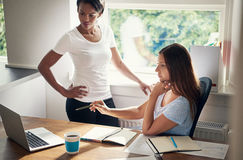Two young businesswomen brainstorming Royalty Free Stock Photo
