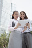 Two young businesswomen discussing outdoors Stock Image