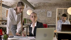 Two young businesswomen are discussing problems in office, networking with technologies, working concept, business. Concept, communication concept stock footage