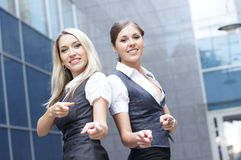 Two young businesswomen in formal clothes Stock Photo