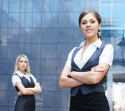 Two young businesswomen in formal clothes Stock Photos