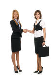 Two young businesswomen are making a deal Royalty Free Stock Photo