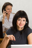 Two young businesswomen in the office Royalty Free Stock Photo