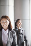 Two young businesswomen outside, portrait Royalty Free Stock Image