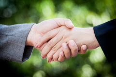 Two young businesswomen shaking hands Stock Photo