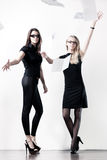 Two young businesswomen throwing out paper Stock Photography