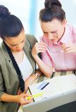 Two young businesswomen working Royalty Free Stock Photography