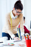 Two young businesswomen working in her office. Royalty Free Stock Image