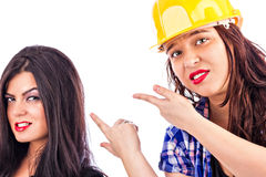 Two young businesswomen working together and competing Royalty Free Stock Image