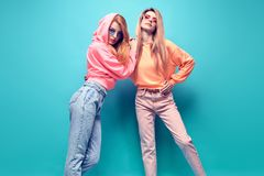 Two hipster Girl Having Fun in Stylish neon Outfit stock photography
