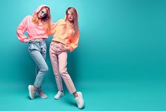 Two hipster Girl Having Fun in Stylish neon Outfit stock photos