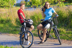 Two Young Caucasian Bikers Resting Outdoors Royalty Free Stock Images