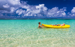 Two young caucasian boys kayaking at tropical sea on yellow kaya Stock Image