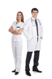 Two young Caucasian doctors in white clothes Royalty Free Stock Images