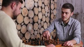Two young caucasian man playing the game of chess. One of a guy win the game. Shake hands in the end of a game. stock video