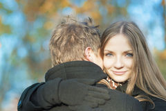 Two young caucasian people embracing in the park Royalty Free Stock Image