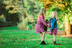 Two Young Caucasian Sisters Holding Hands royalty free stock images