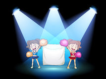 Two young cheerdancers at the stage with an empty banner. Illustration of the two young cheerdancers at the stage with an empty banner Stock Photography