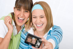 Two young cheerful woman taking picture Stock Image