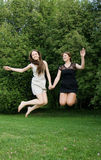 Two Young Cheerful Women Jumping Royalty Free Stock Photography