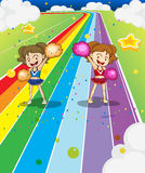 Two young cheerleaders dancing at the colorful road. Illustration of the two young cheerleaders dancing at the colorful road Stock Images