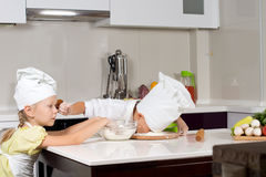 Two young chefs having fun Royalty Free Stock Images