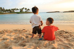 Two young children on a beach. Royalty Free Stock Photography