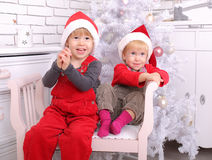 Two young children at christmas royalty free stock image
