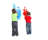 Two young children painting over white Royalty Free Stock Images