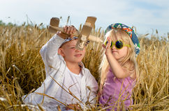 Two young children playing with a model plane Royalty Free Stock Photos