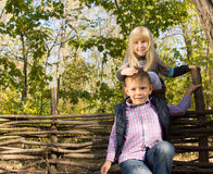 Two young children playing outdoors in woods Stock Photos